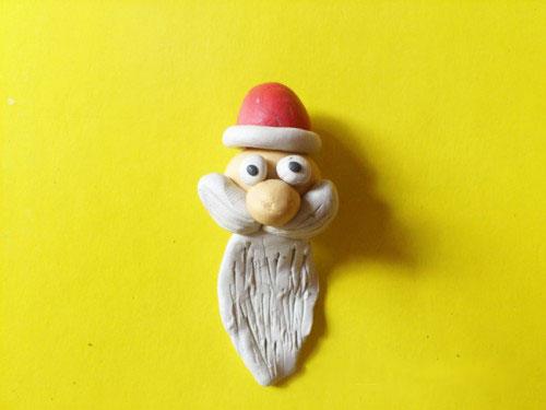 Голова с бородой, усами и шапкой из пластилина