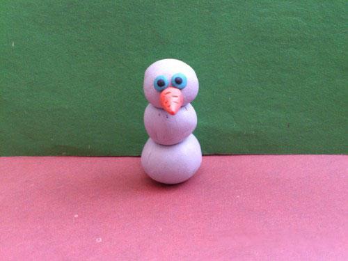Лицо снеговика из пластилина
