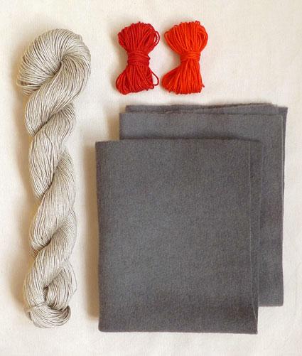Подушка вышитая на вязаном полотне 1