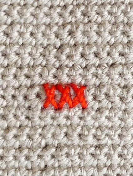 Подушка вышитая на вязаном полотне 7
