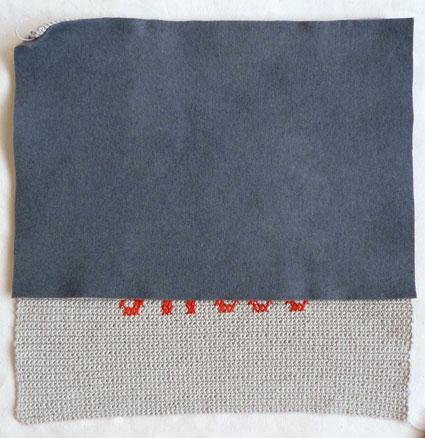 Подушка вышитая на вязаном полотне 9
