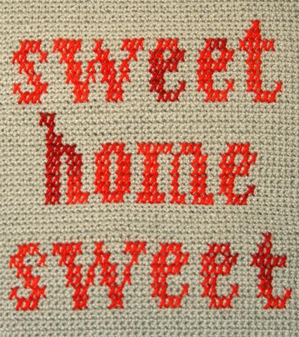Подушка вышитая на вязаном полотне 11