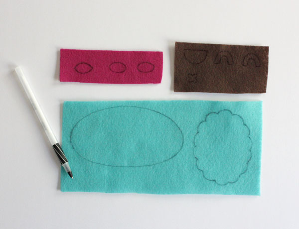 Монстрики из фетра-наведите детали на фетре