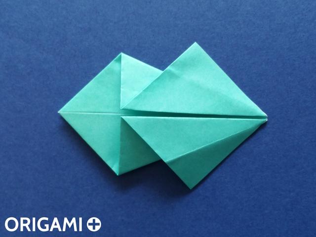 Оригами рибка-раскройте верхние клапаны