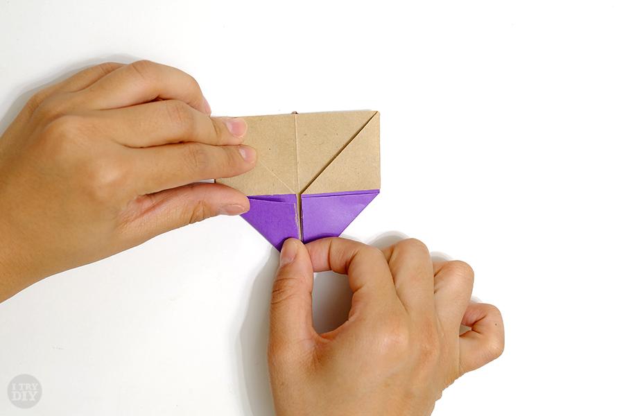 Оригами подставка для яиц-заверните левый угол вверх