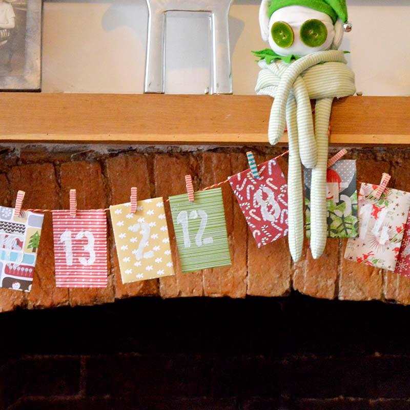 Адвент календарь из бумаги - подвесьте конверты на веревку