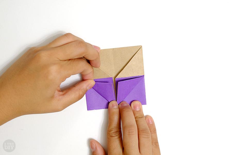 Оригами подставка для яиц-заверните нижний левый угол вверх